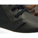 Bota tipo zapatilla combinada con cordones en piel con lona.