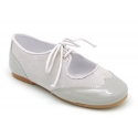 Combined leather Ballet flat shoes with ties closure.