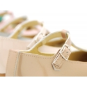Patent leather little T-strap Mary Janes in pastel colors.