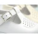 New T-strap shoes for babies with perforated design.