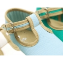 Classic cotton canvas T-Strap shoes for babies with hook and loop strap.