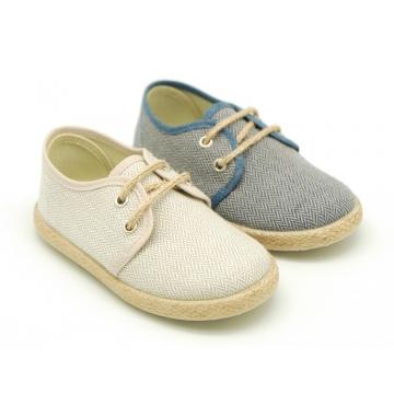Cotton canvas laces up shoes esparile style with spike design.