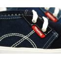 Bota tipo zapatilla con cordones en lona y serraje.