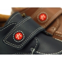 Washable leather boat shoes with velcro strap for little kids.
