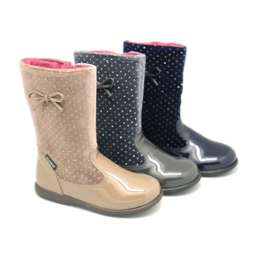 New combined boots in shiny velvet canvas with patent finish.