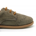 Classic suede leather Laces up shoes with perforated design for autumn.