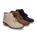 Ankle boots with tassels in suede leather combined with metal suede leather.