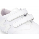 Tennis style shoes for babies with hook and loop strap in soft leather combined with patent leather.