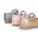 Classic Little Mary Janes with hook and loop strap with flower in pearl nappa leather.