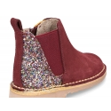 New ankle boots with elastic band and zipper closure with glitter counter.