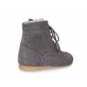 Classic Pascuala style ankle boots with ties with TASSELS in suede leather.