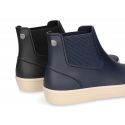 Ankle rain boots with elastic band and SNEAKER DESIGN.