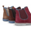 New ankle boots with soles in contrast and zipper closure in suede leather.