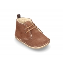 Little Safari boots for babies with ties closure and wool knit lining.