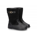 Combined padded boots in leather and velvet canvas in black color.