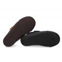 Botita sport tipo zapatilla para vestir sin cordones en piel serraje.