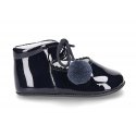Little classic Mary Jane shoes with POMPONS in patent leather.