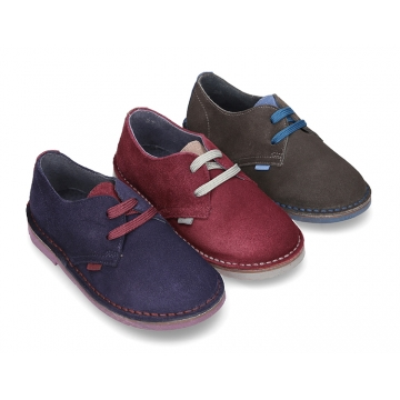 New Classic suede leather Laces up shoes with combined tongue and soles.