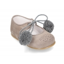 Suede leather little classic Mary jane shoes with POMPONS ties closure.
