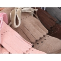 Classic suede leather little bootie with fringed design.