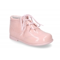 Classic patent leather English style bootie for first steps in pastel colors.