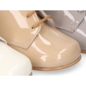 Classic patent leather ankle boots to dress for first steps.