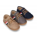 New autumn winter canvas tennis style shoes with flag detail.