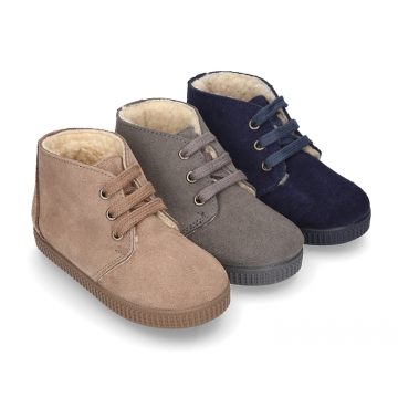 New suede leather little bootie sneaker style with fake hair lining.