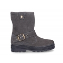 Suede leather boots with buckle design and zipper closure.