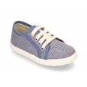 New cotton canvas tennis shoes with spike design.