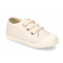 Soft cotton canvas tennis shoes with toe cap.