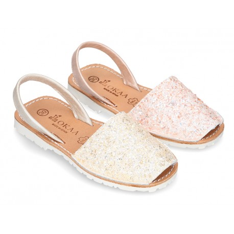 New Menorquina sandals with rear strap in pearl nappa leather with crystals design.