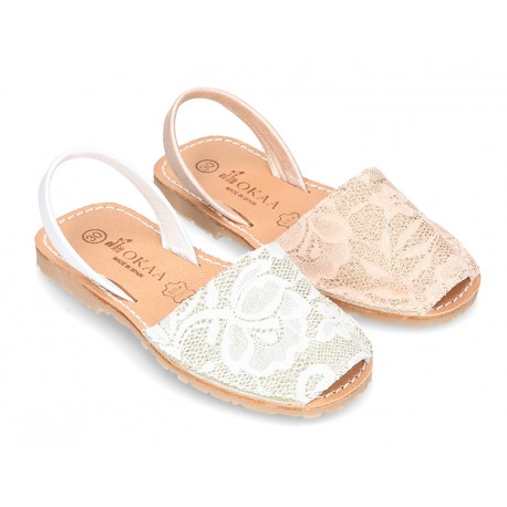 New Menorquina sandals with rear strap in pearl nappa leather with laces design.