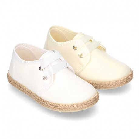 Special CEREMONY laces up shoes espadrille style with ties closure.