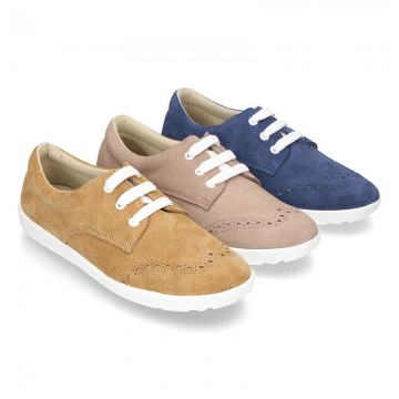 Classic suede leather Laces up shoes tennis style with ties closure and perforated design.