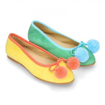Soft suede leather classic ballet flats with pompons.