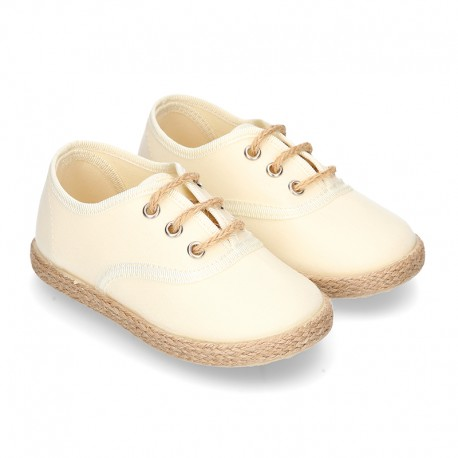 Special CEREMONY kids laces up shoes espadrille style.
