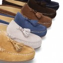 Suede leather moccasin shoes with tassels and driver type Outsole for toddler boys.