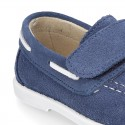 Suede leather Boat shoes with velcro strap.