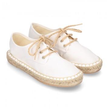 Laces up espadrille shoes in WHITE cotton canvas.