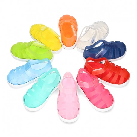 Tennis style jelly shoes with VELCRO strap for Beach and Pool.