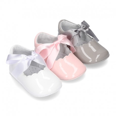 Patent leather Little Mary Janes angel style with waves and ties.