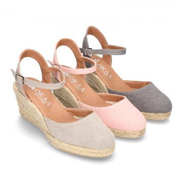 3f7bd68b5434 Wedge canvas sandal espadrille with buckle fastening in washing effect.