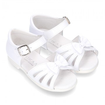 New patent leather sandals with ribbon and super flexible soles for little girls.