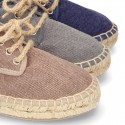 Laces up espadrille shoes in washing effect cotton canvas.