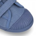 New Canvas Sneaker with toe cap and double velcro strap.