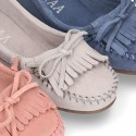 Indian style Moccasin shoes with bows in suede leather for girls.
