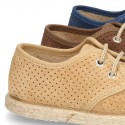 Laces up shoes espadrille style in suede leather little dots effect.