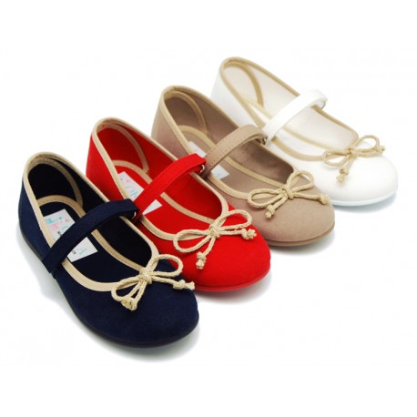 Cotton Canvas Ballet flat shoes with hook and loop strap and contrast bow for girls.
