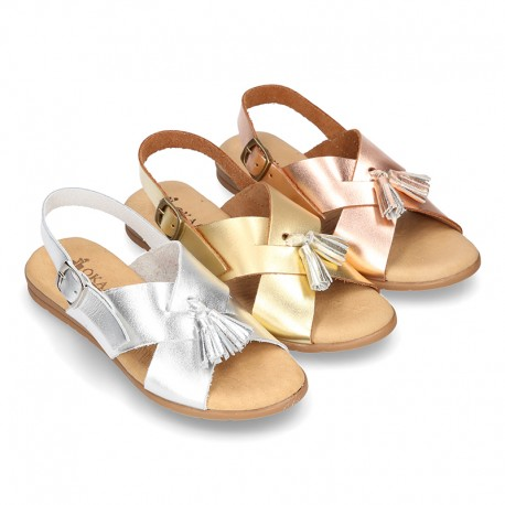 Metal Leather sandal shoes with crossed straps and tassels.